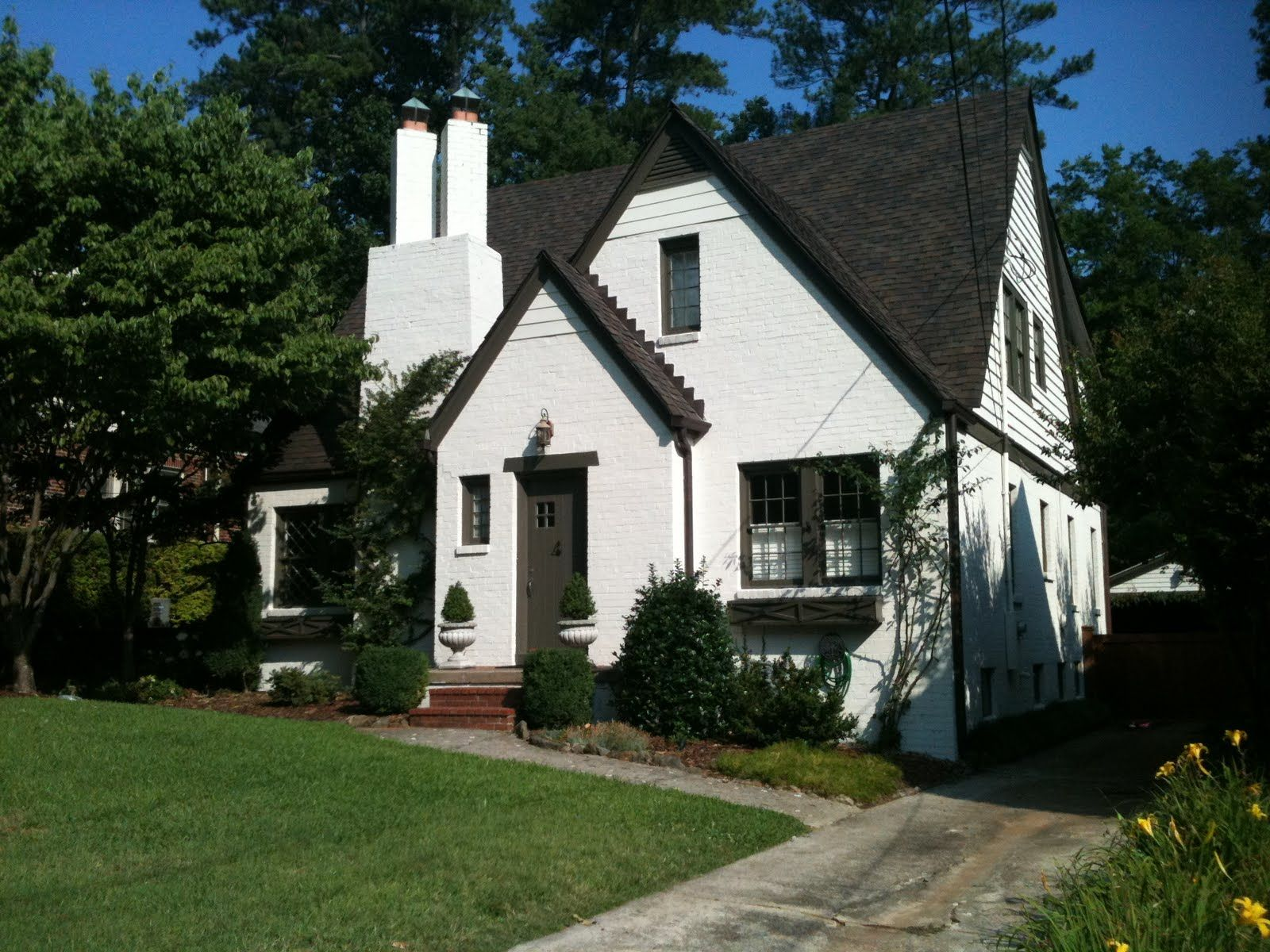 White painted brick house with grey roof google search