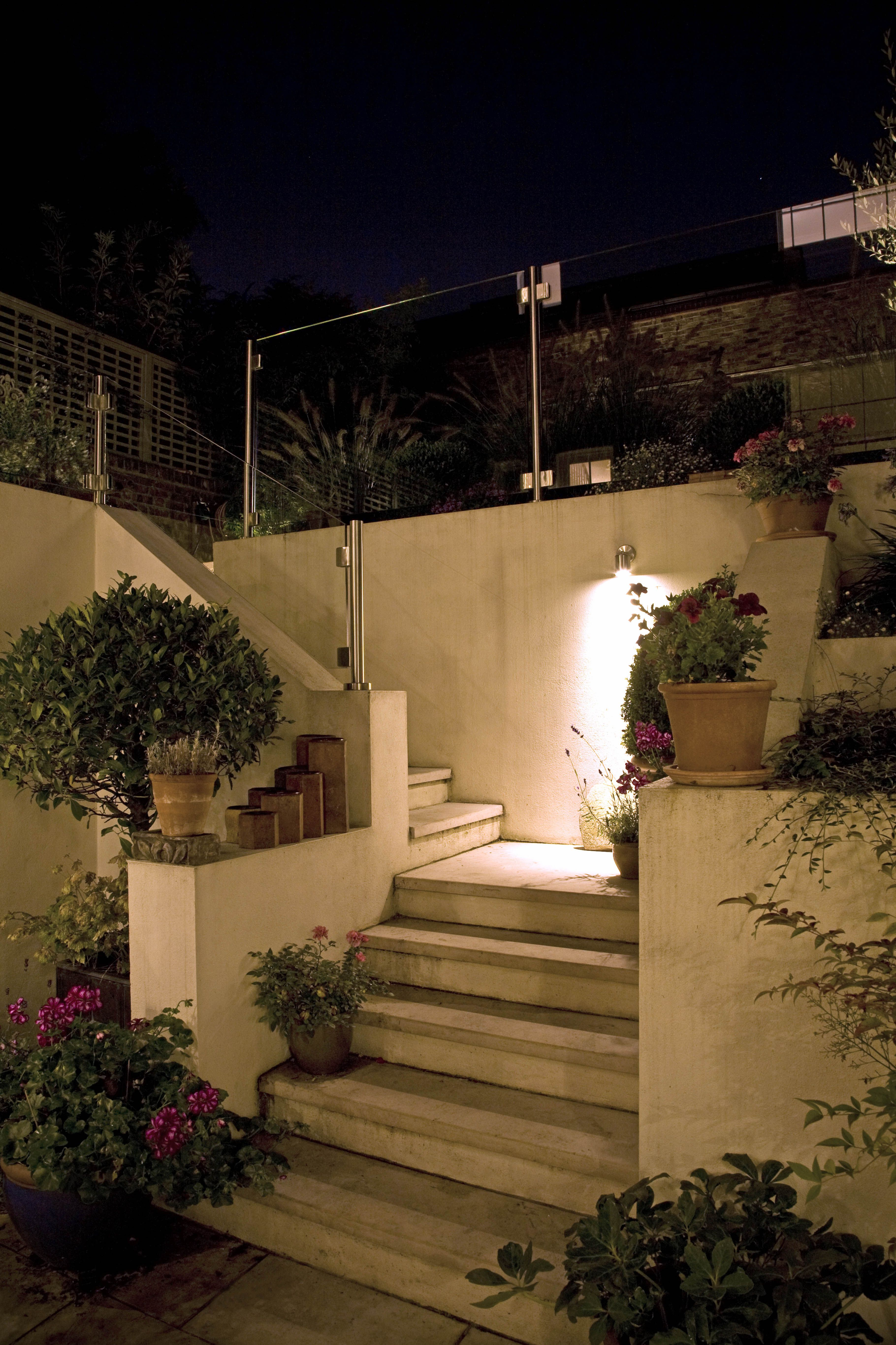 For this small garden in london we used a hunza wall down light in for this small garden in london we used a hunza wall down light in stainless steel aloadofball Image collections
