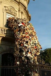 I just love this art installation. It looks like the building is vomiting #books.