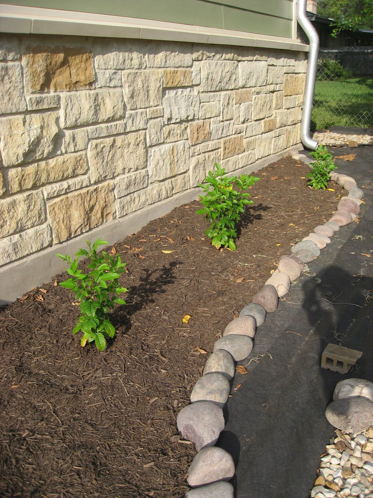 river rock edging outside pinterest rock edging