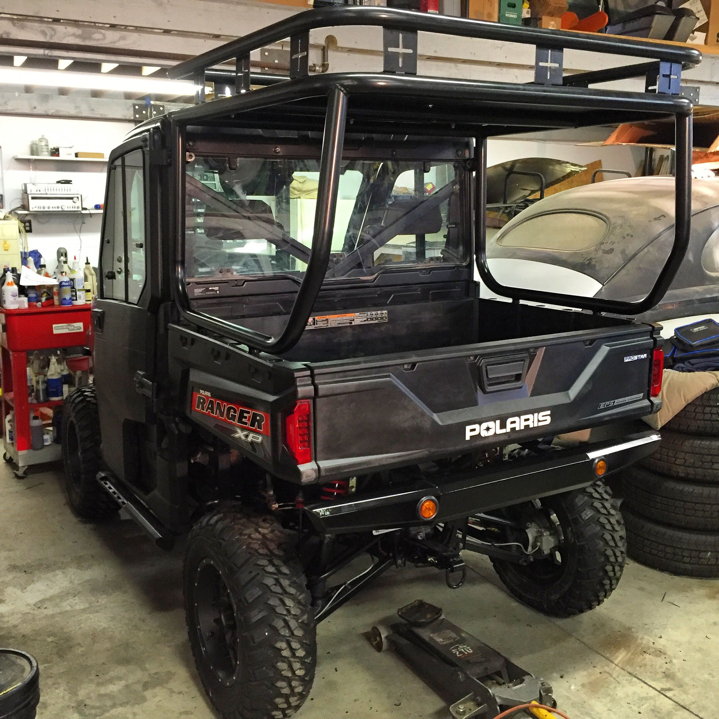 Roll Cage Roof And Safari Rack Installed On A Polaris