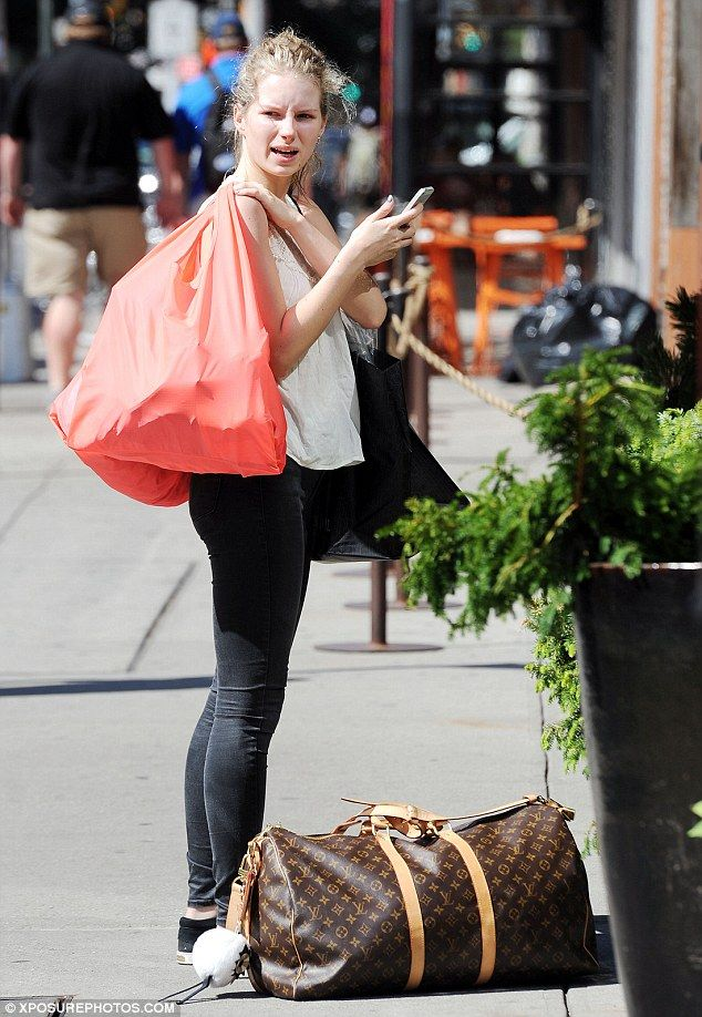 Off-duty model: Lottie Moss, 18, stepped out in New York in a sleeveless white blouse and ...