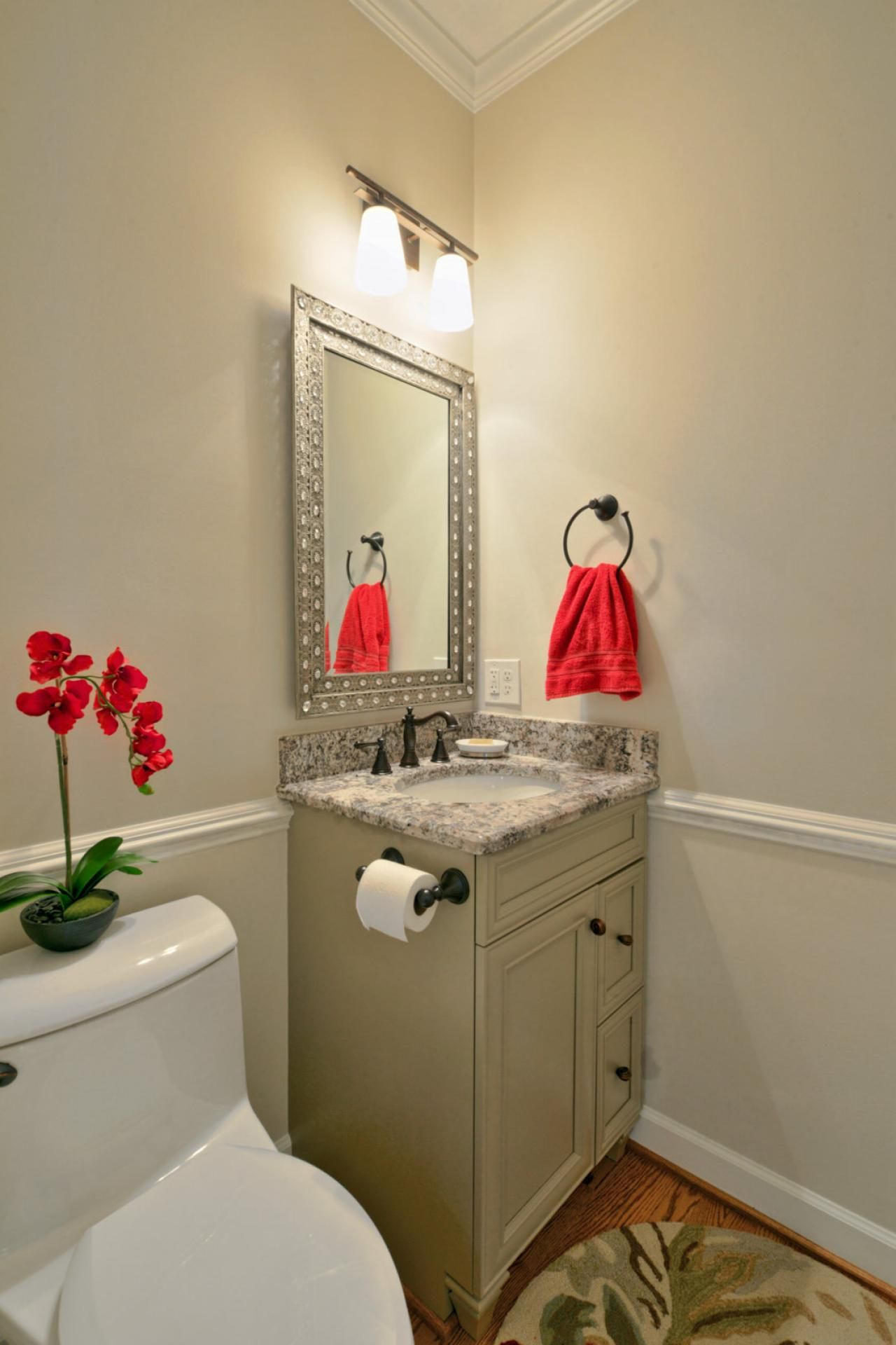A Corner Vanity Leaves The Majority Of Floor E Open In This Traditional Neutral Bathroom