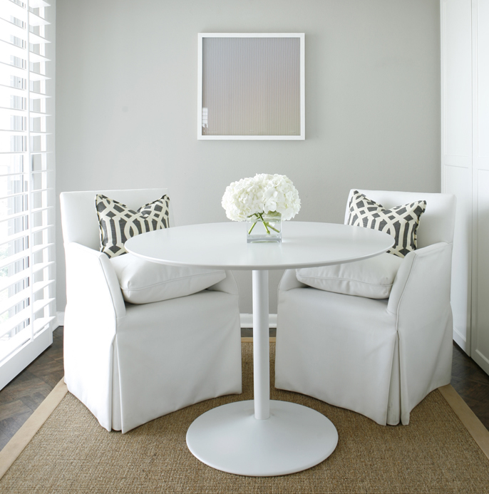 white & gray dining room design with white tulip table, white