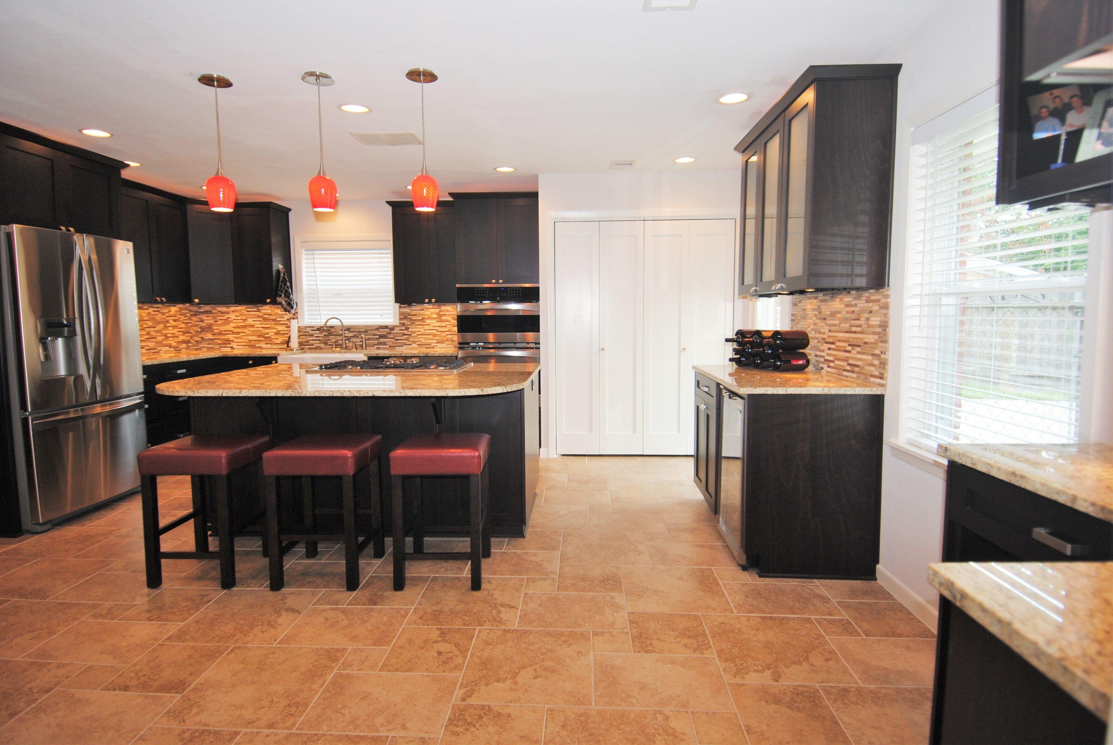 Dramatic Espresso Wood Cabinets Horizontal Backsplash Oversized Island With Cooktop Wine Frig