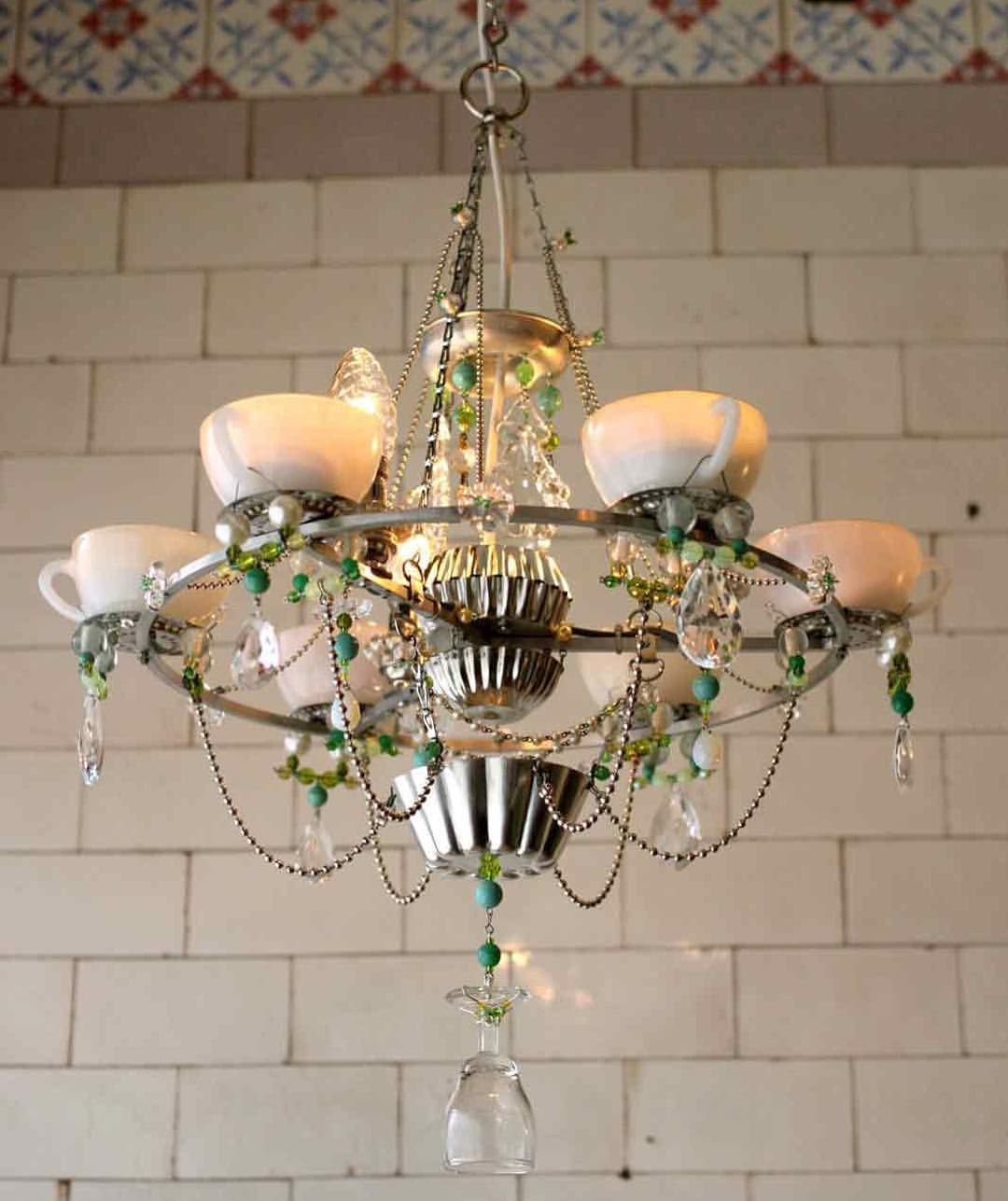 Opal Cup Chandelier, old dairy tiles on the background.