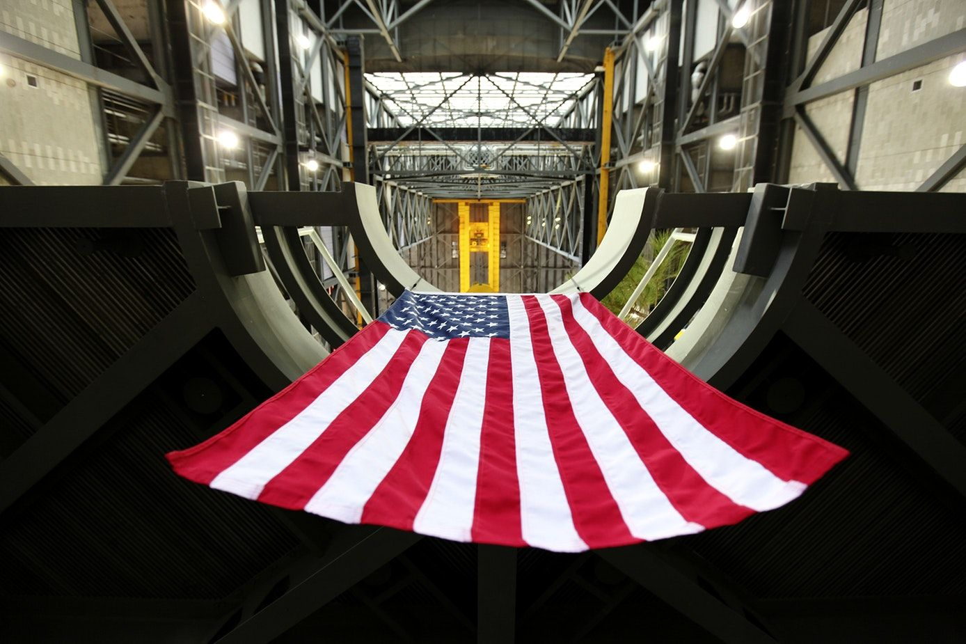 In a view from below, the American flag is in view hanging