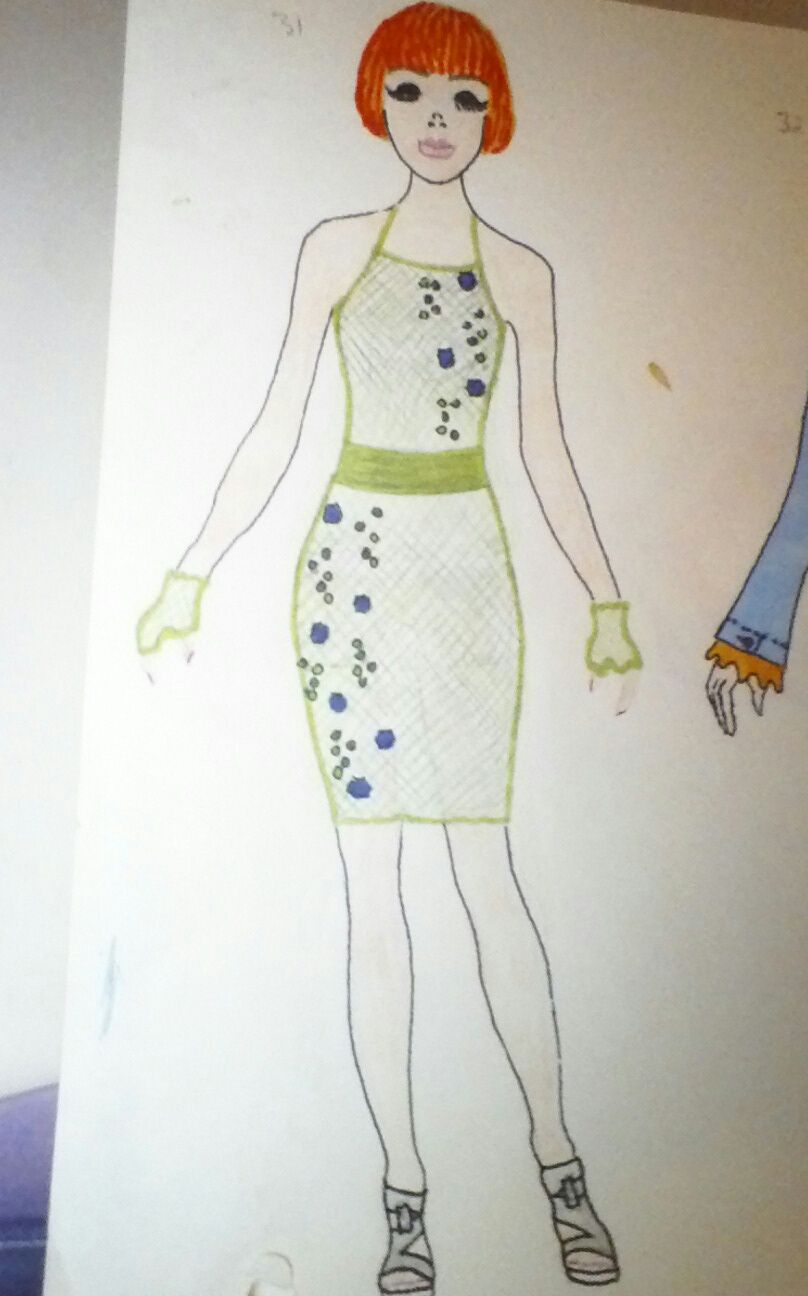 Dark blue and green jewels on front of net dress. Shana