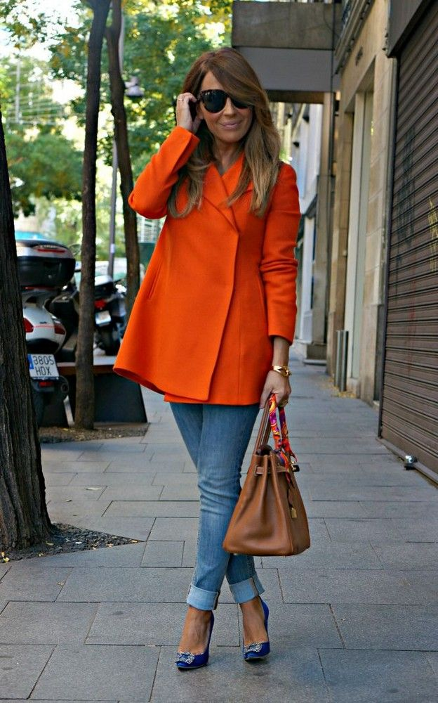 dea7c30b32f 27 Looks with Hangisi Manolo Blahnik. Glamsugar.com Long-sleeve  midthigh-length lapelled pumpkin-orange coat