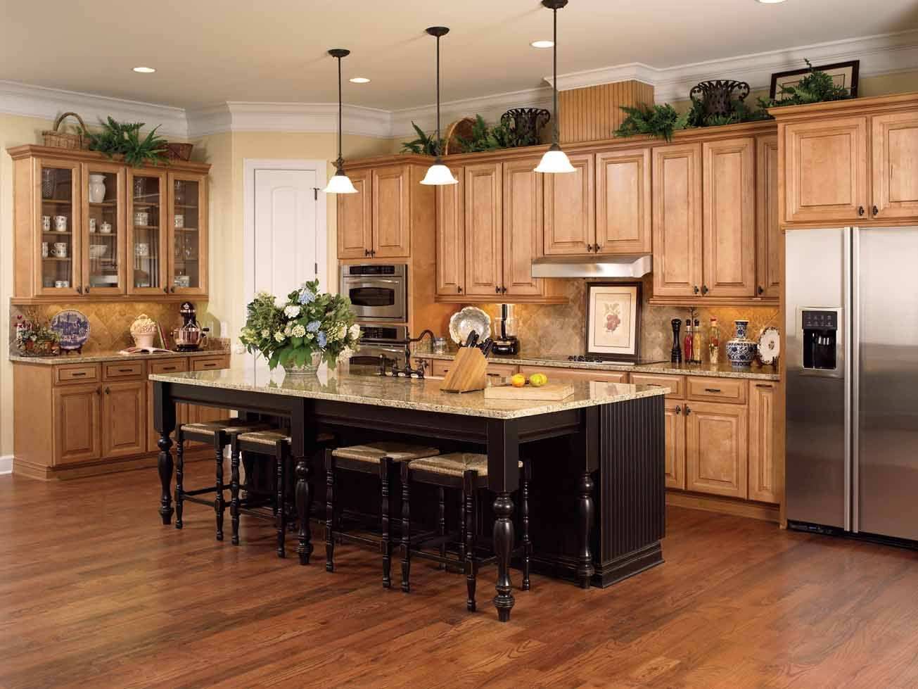 honey colored oak cabinets with dark wood floor and black island design kitchen renovation on kitchen ideas colorful id=27507