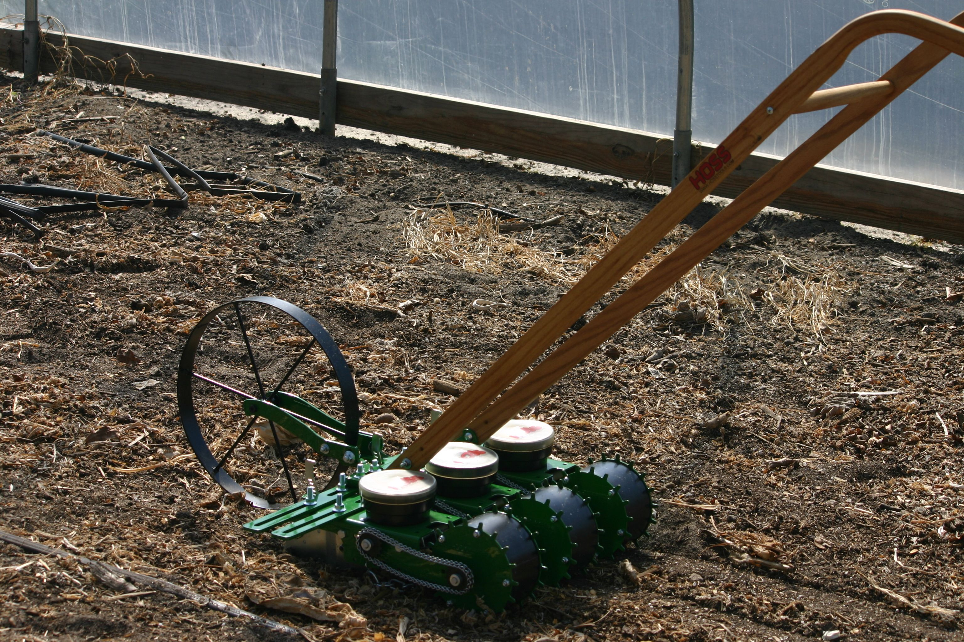 This Incredible Wheel Hoe And Seeder Setup Allows You To Plant Multiple Rows At A Time Using Four Spreader Bar Exten Garden Seeds Indoor Seed Starting Planters