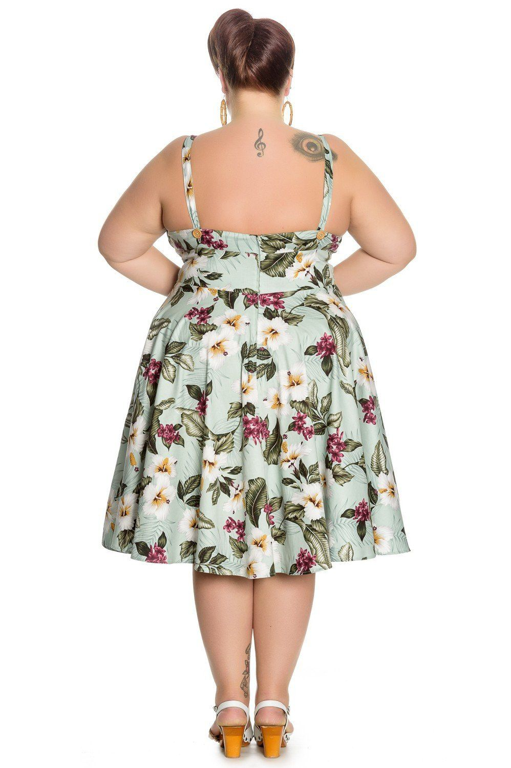 c51c8c26f633 50's flare dress by Hell Bunny with print of hibiscus flowers on a green  background. 11 wooden look buttons at the front. Straps with buttons at the  back to ...