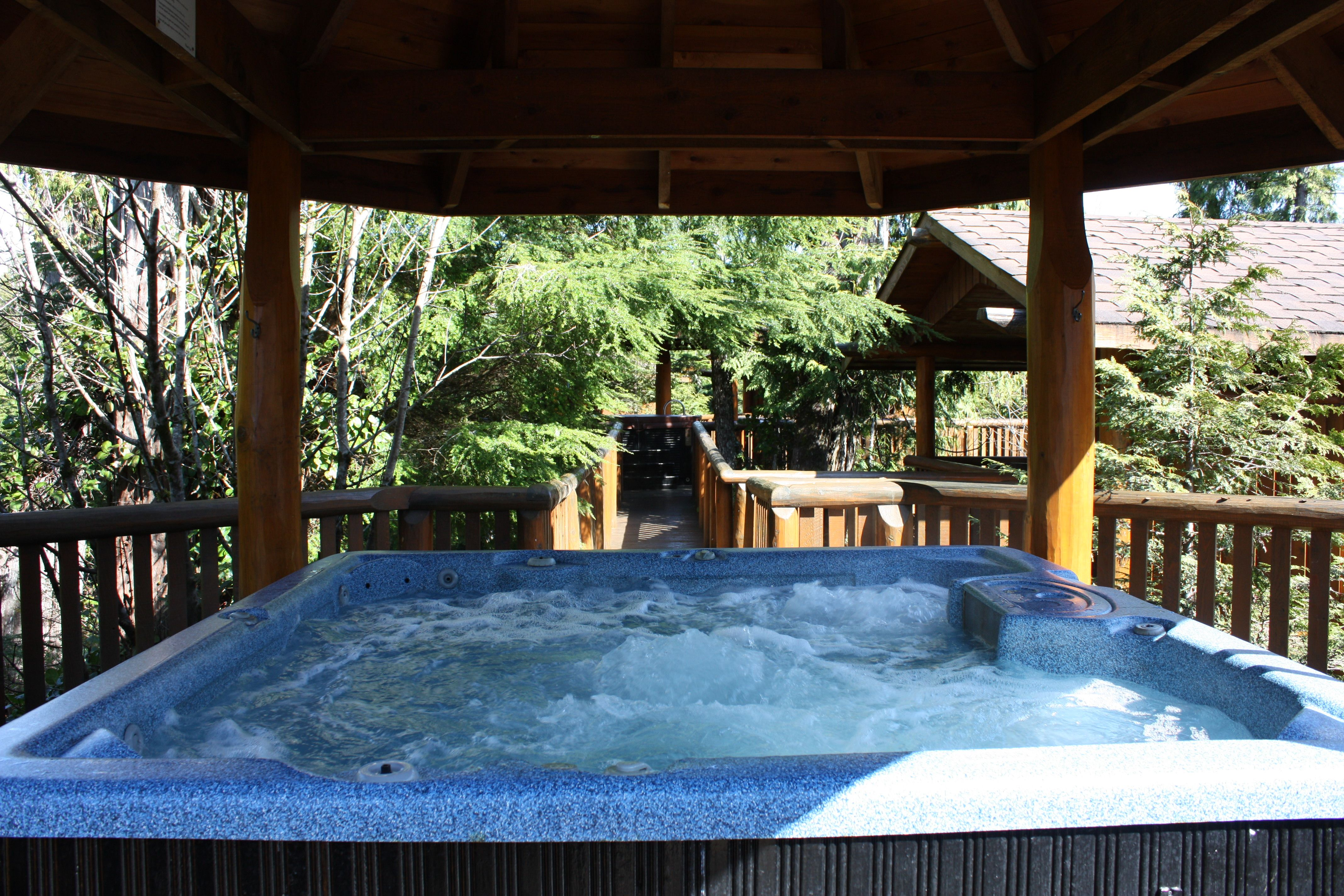 Relax In A Hot Tub In The Trees In Our Rainforest Cabins Treehouse Cabins Cabin Hot Tub