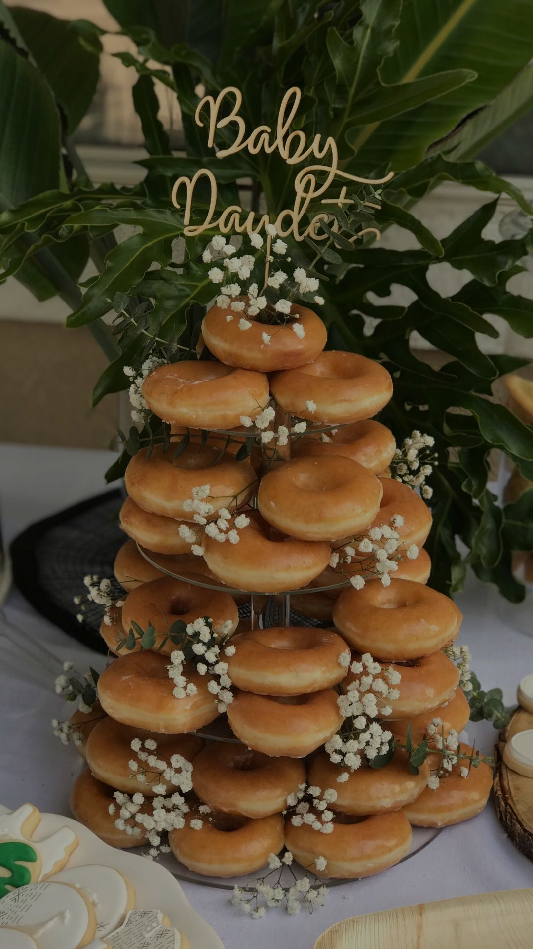 Donut Cake Tower With A Acrylic Stand Flowers And Customized Cake