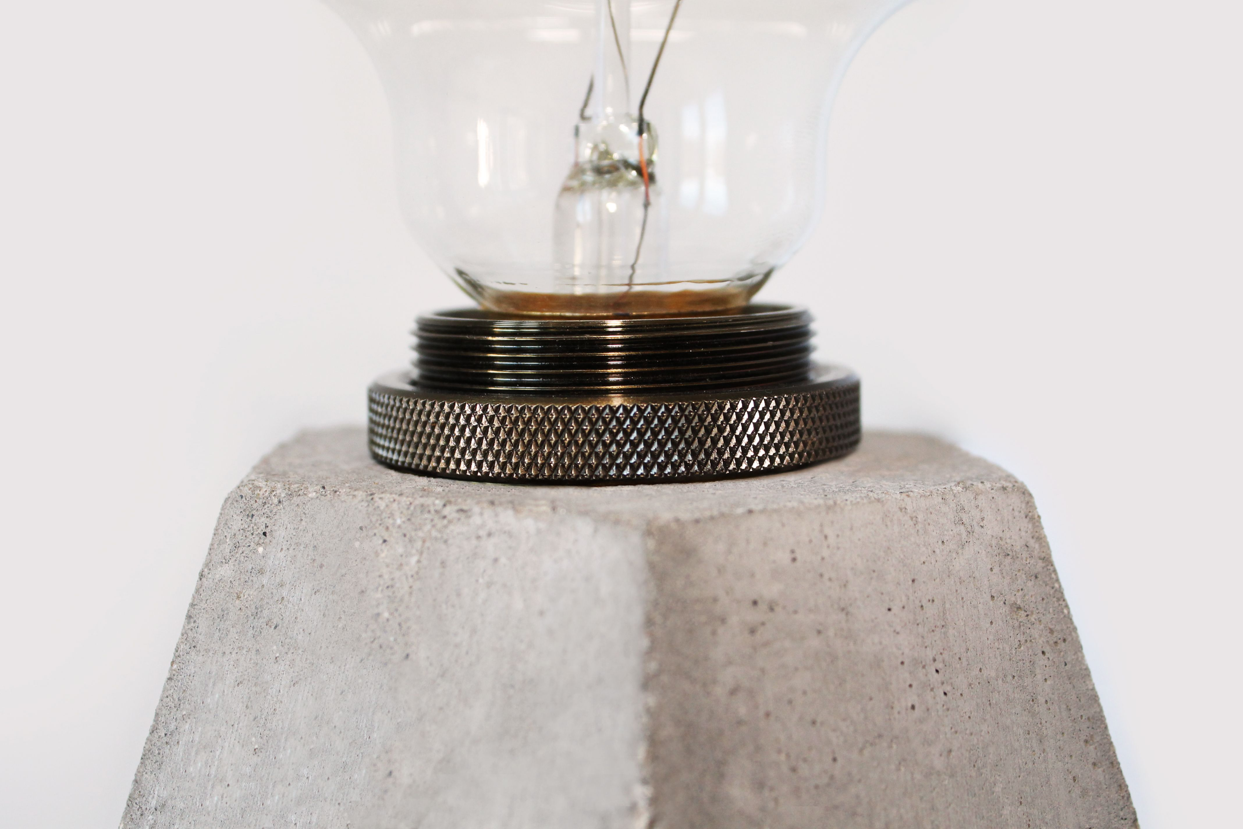 Close up on Rough Diamond Lamp in concrete by Edgy + Rocks.