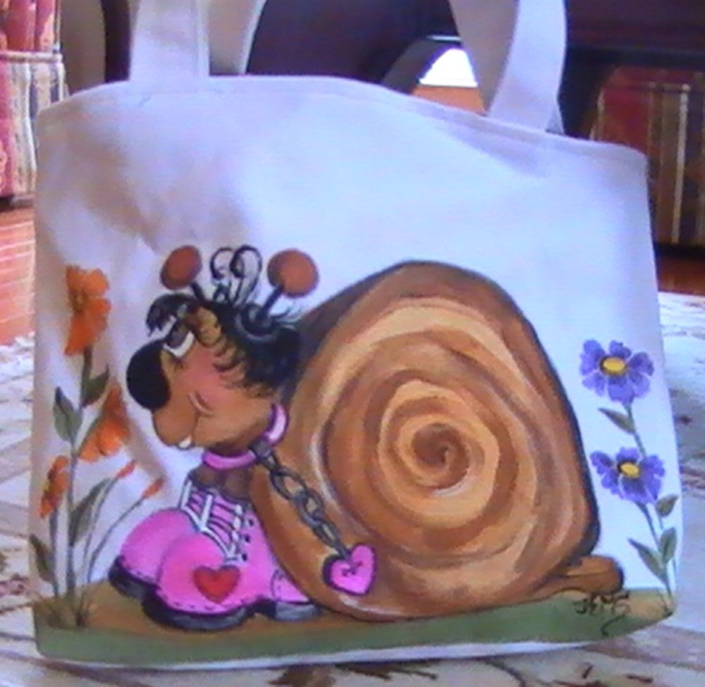 This is a hand painted illistration on canvas, then turned into a bag with coordinating fabric for the linning. This is a girl snail with pink boots and a charm heart handing around her neck.