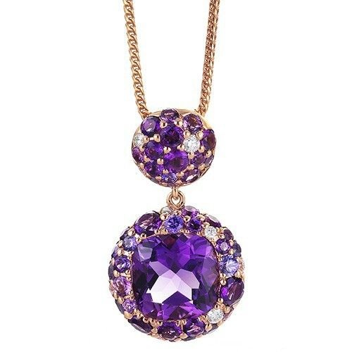 18k Rose gold pendant set with a cushion-cut amethyst surrounded by purple…