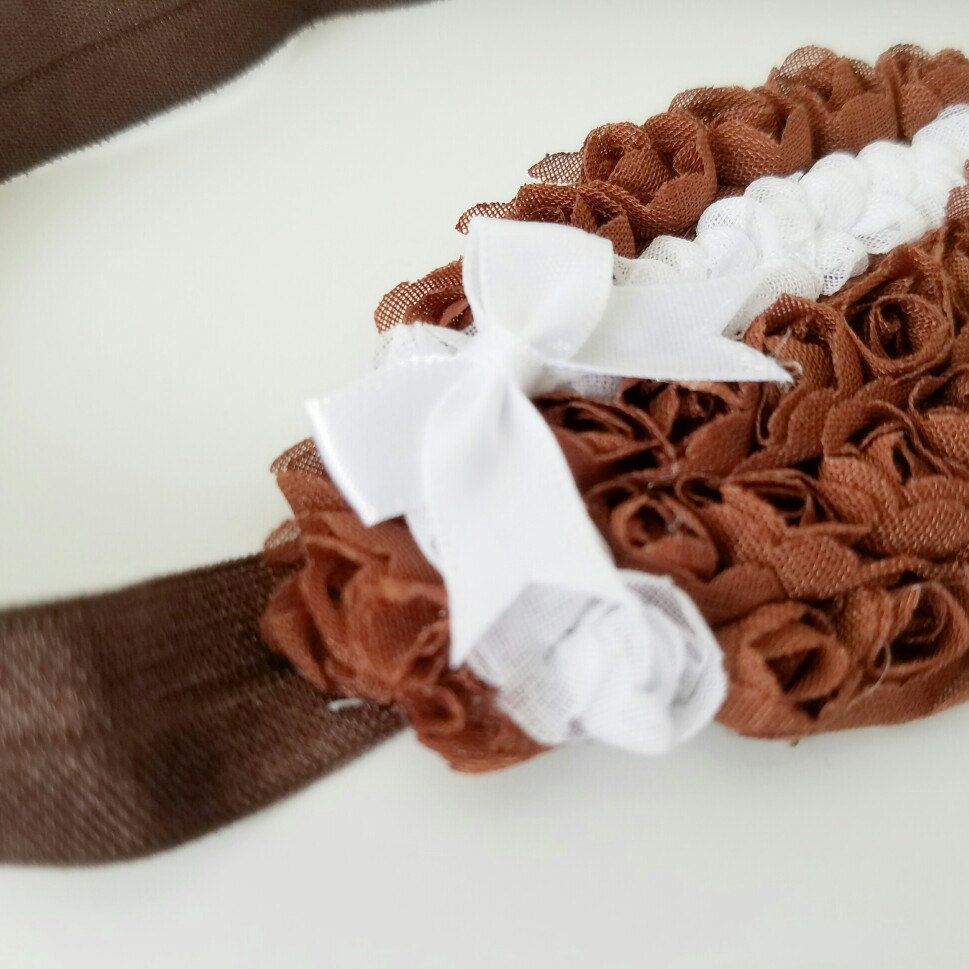 Sweet little bow on the new football headband, perfect for your little cheerleader!