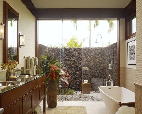 It would be a real shame to live in Hawaii and not have some sort of outdoor bathing setup. This one has an indoor tub and an outdoor shower surrounded by a volcanic rock wall. Privacy, luxury and tropical breezes.  by Slifer Designs