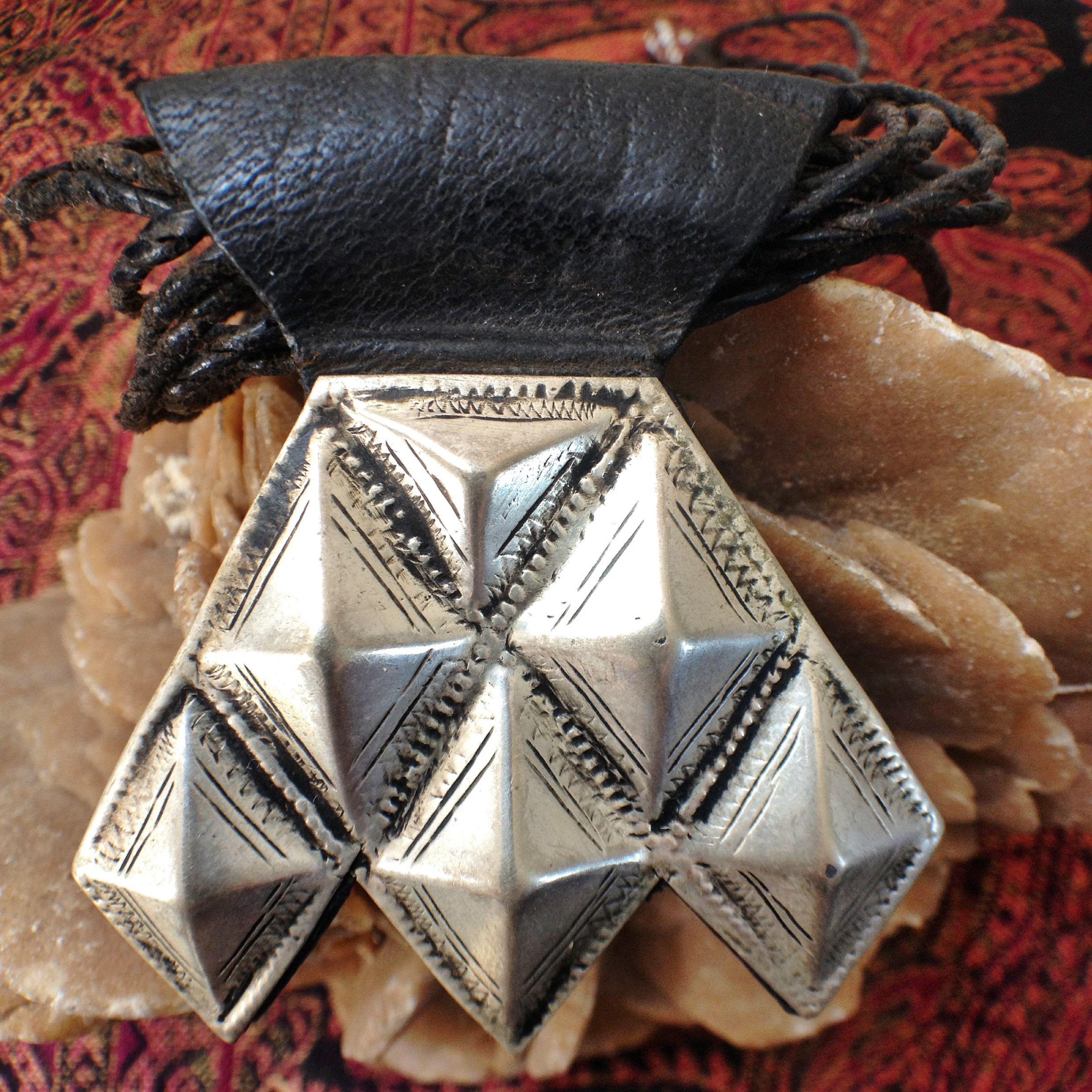Tuareg Silver Khomeisa on Leather with Goatleather Cords, South Algeria MORE INFO: https://www.etsy.com/listing/243136805/tuareg-silver-khomeisa-on-goatleather BY INEKE HEMMINGA
