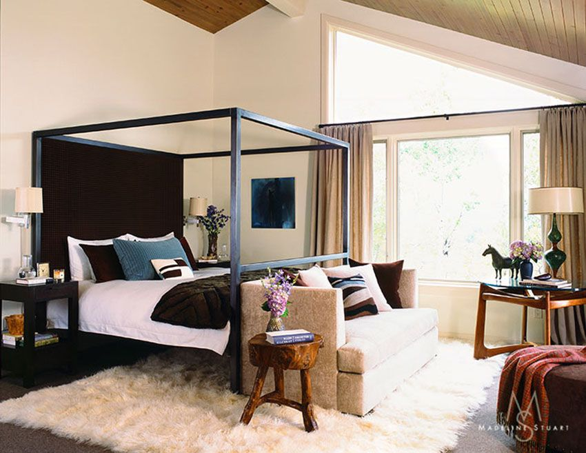 Black Four Poster Bed Sofa At End Of Cream Rug Wood Ceiling