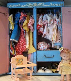 A wardrobe full of vintage doll clothes..
