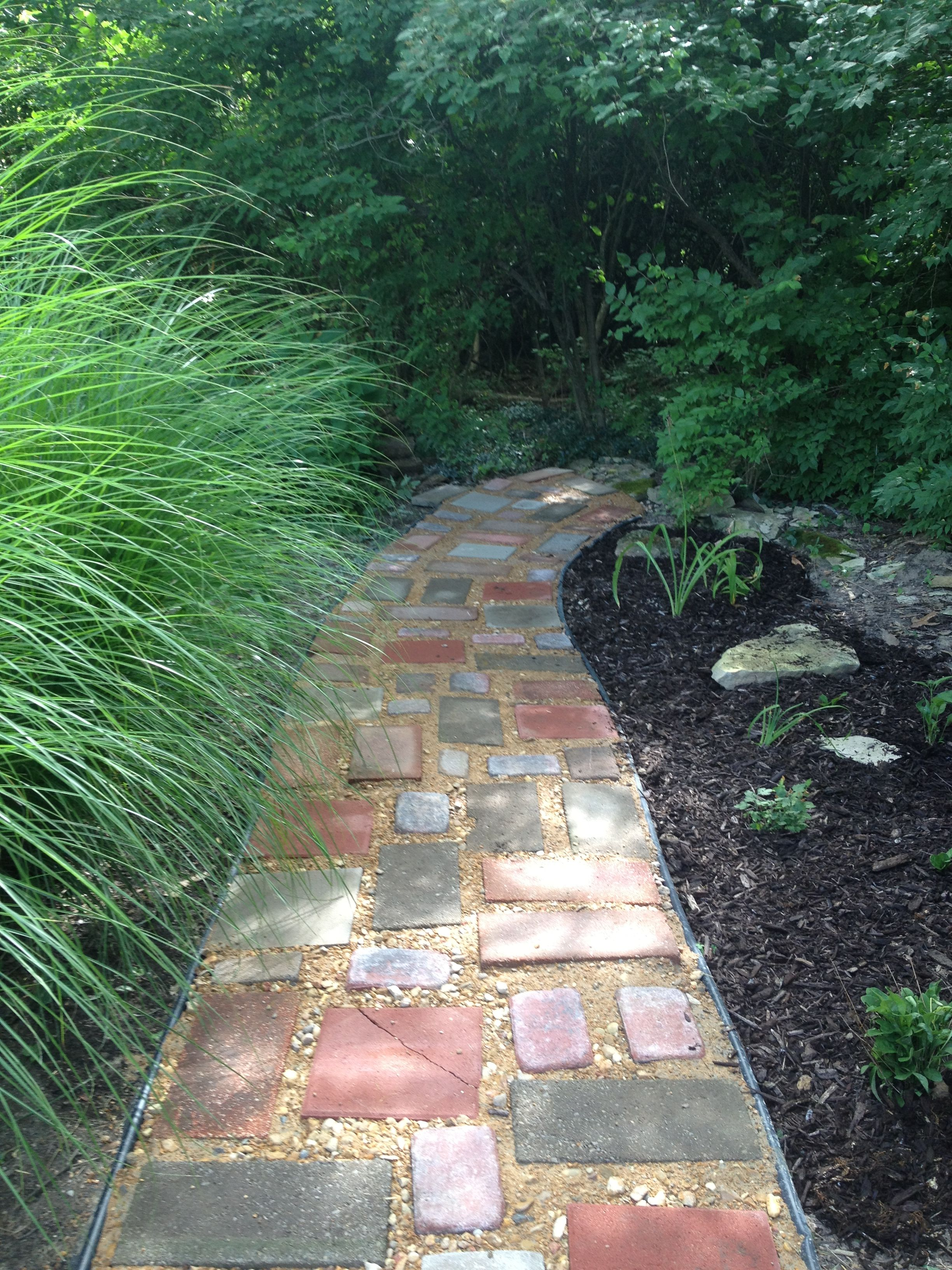 Diy garden path on a budget recycled pavers left over for Garden path