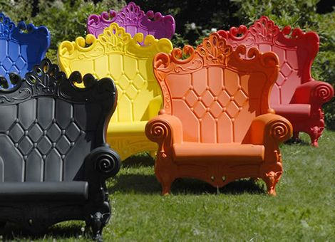 Colorful baroque outdoor chairs. Love!