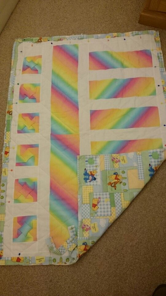 Cathedral window block with Winnie the Pooh backing fabric.  Made for a very special baby ; Megan