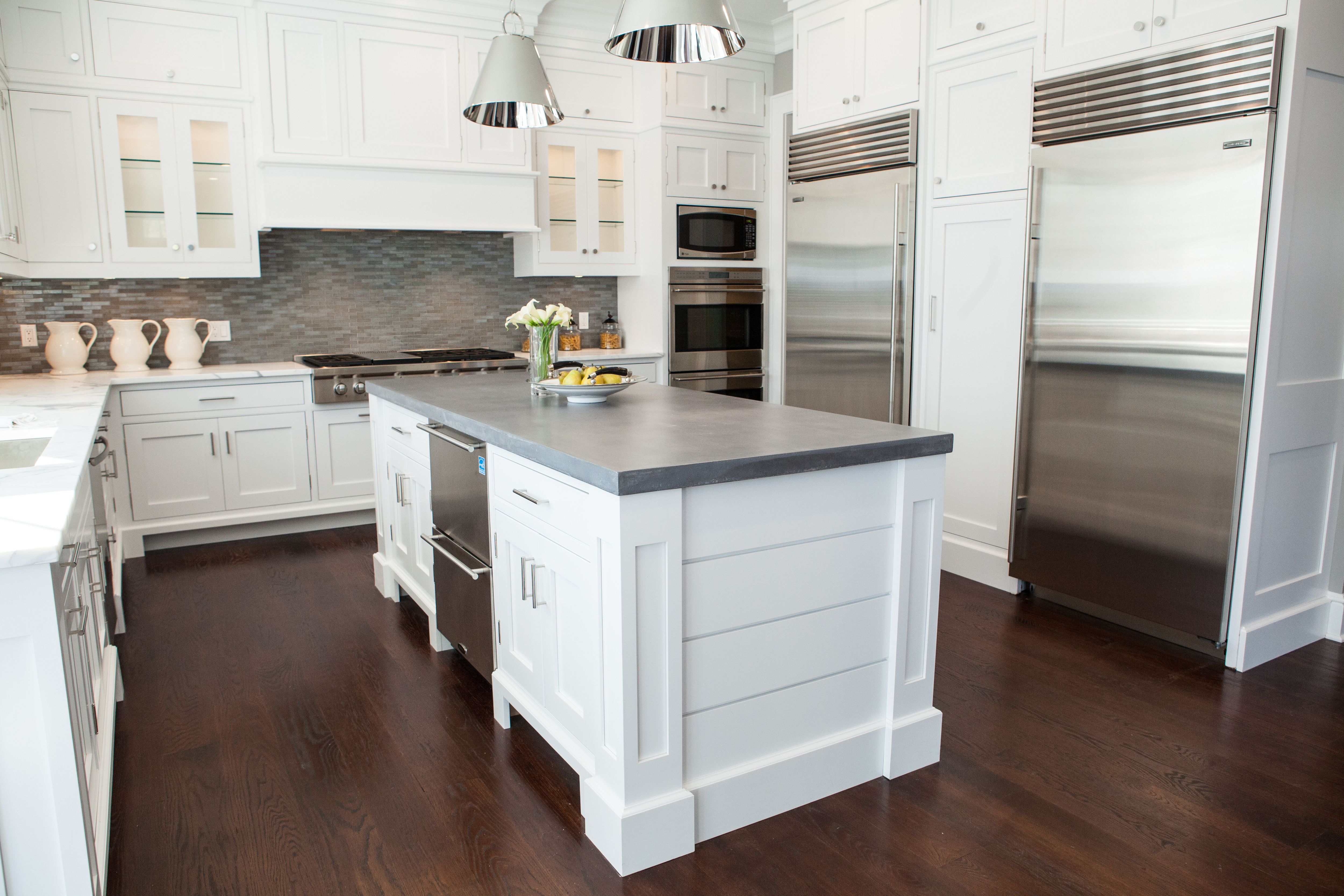 White Kitchen with a Concrete Island and Dark Wood Floors   Haus