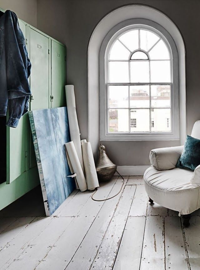 Industrial vintage. Metal lockers as a closet, white old wooden floors, white armchair