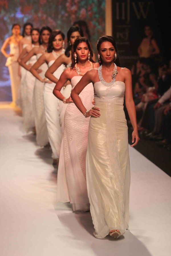 Models walk the ramp of the Indian International Jewellery Week