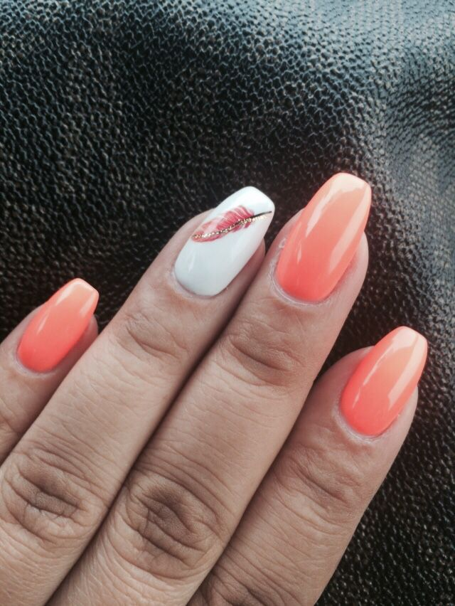 My own personal design. Coffin shaped, neon peach color with a feather  accent nail - My Own Personal Design. Coffin Shaped, Neon Peach Color With A