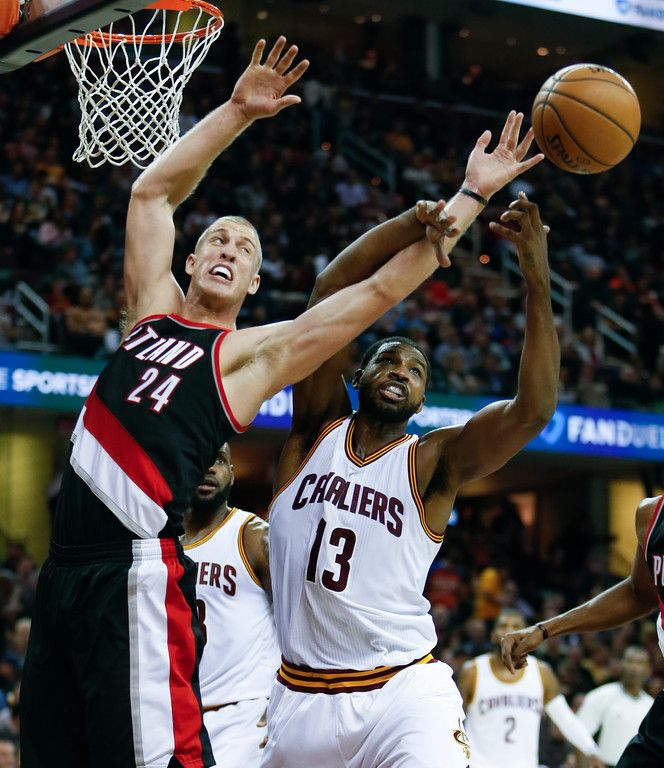 Portland Trail Blazers Mason Plumlee  And Cleveland Cavaliers Tristan Thompson  Battle For A Rebound During The Second Half Of An Nba Basketball