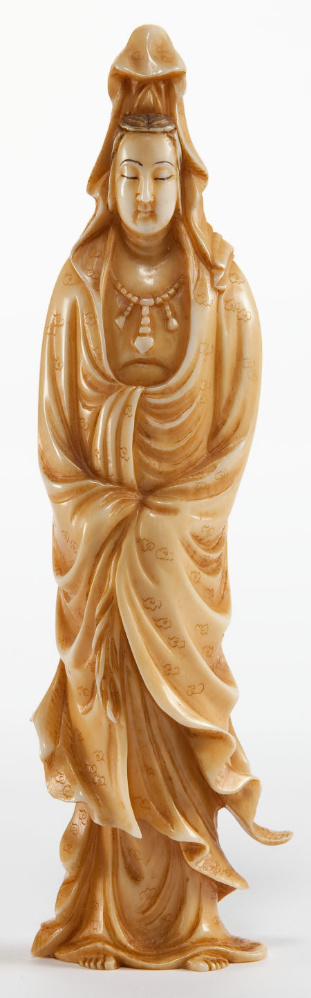 A CHINESE INDIAN-STYLE CARVED IVORY FIGURE  Circa 1900
