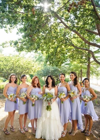 9fffab57a3b Beautiful bridesmaids in lavender gowns. Bridal gown from Bella Rose  Bridal. Wedding by Leslie Herring Events. Photo by Holli B. Photography.