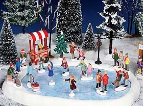 Christmas Village Ice Skating Rink.Photo Showing Lemax Ice Skating Pond In Landscaped Setting