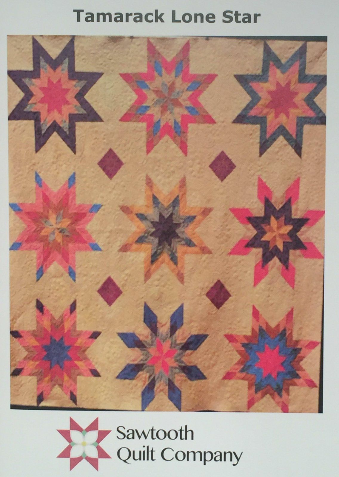 Tamarack Lone Star quilt pattern, a large, strip-pieced rustic Lone Star and Sawtooth Quilt Company original design.