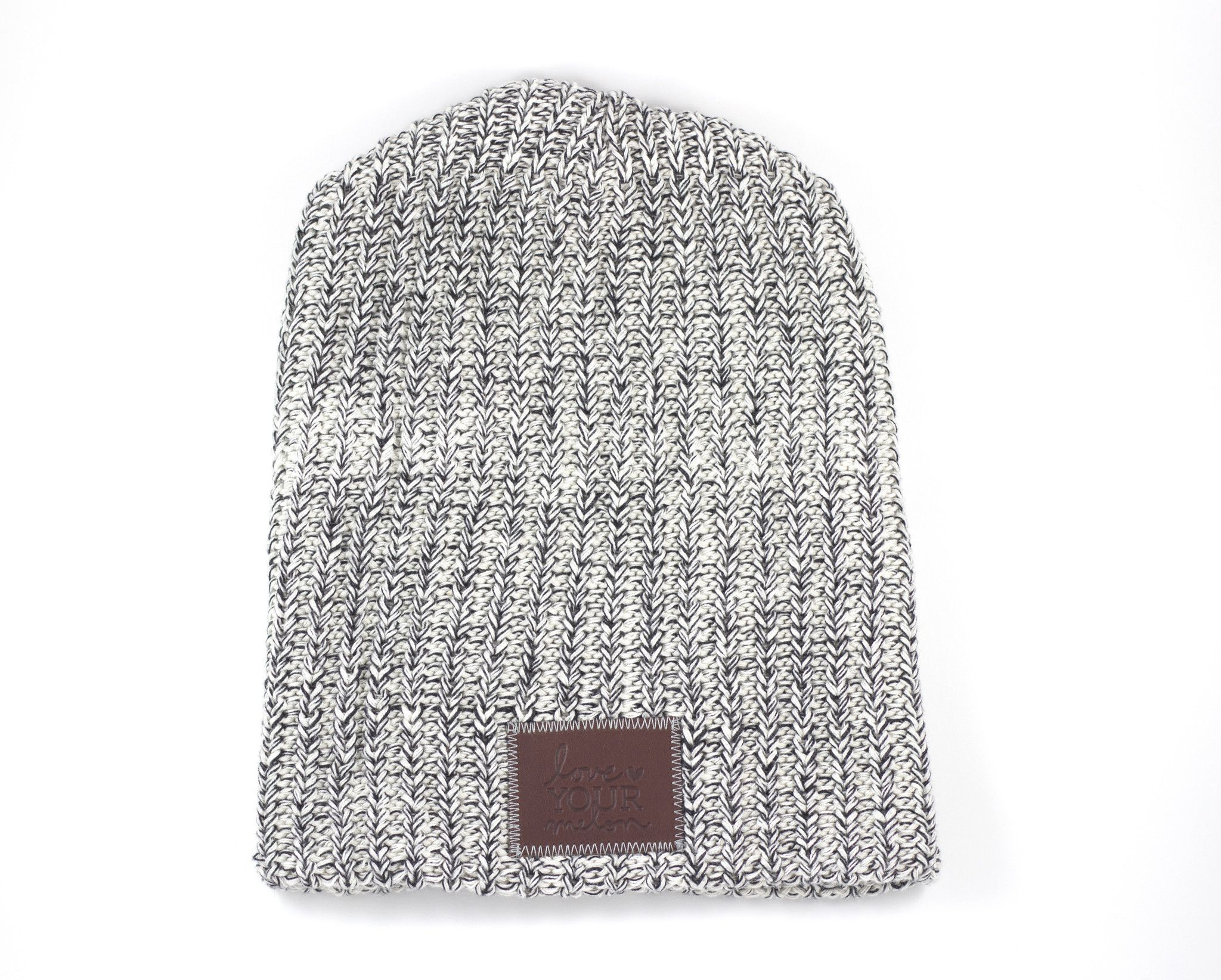 This beanie is knit out of 100% cotton yarn in white and black colors and  features a brown leather patch that is debossed with the Love Your Melon  logo. 87525e2972c6
