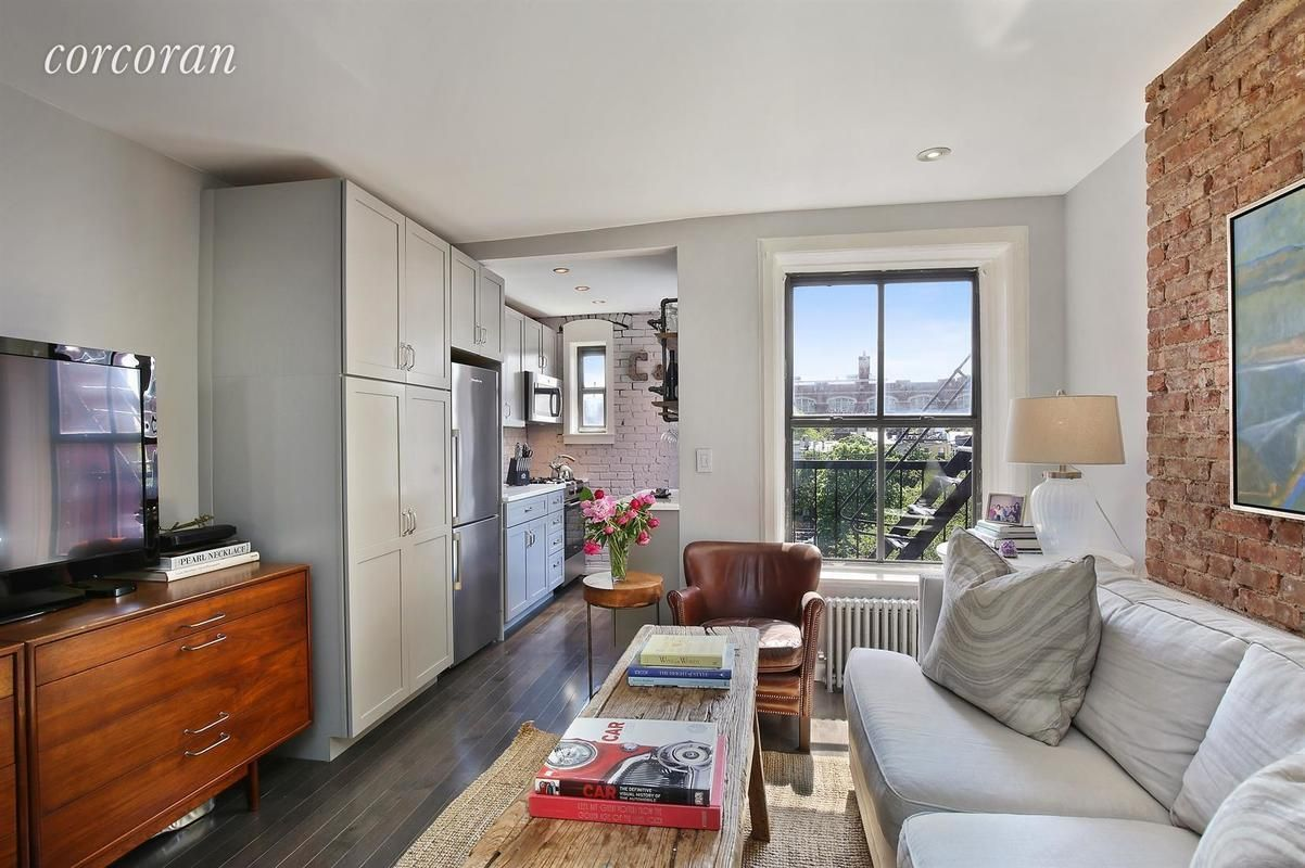 Rusticchic Cobble Hill condo with East River views wants