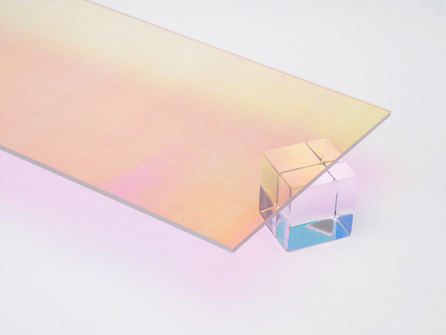 a special rainbow colored iridescent acrylic sheet this unique sheet has a subtle mirror like finish and changes color with viewing angle its transparent - Colored Transparent Sheets
