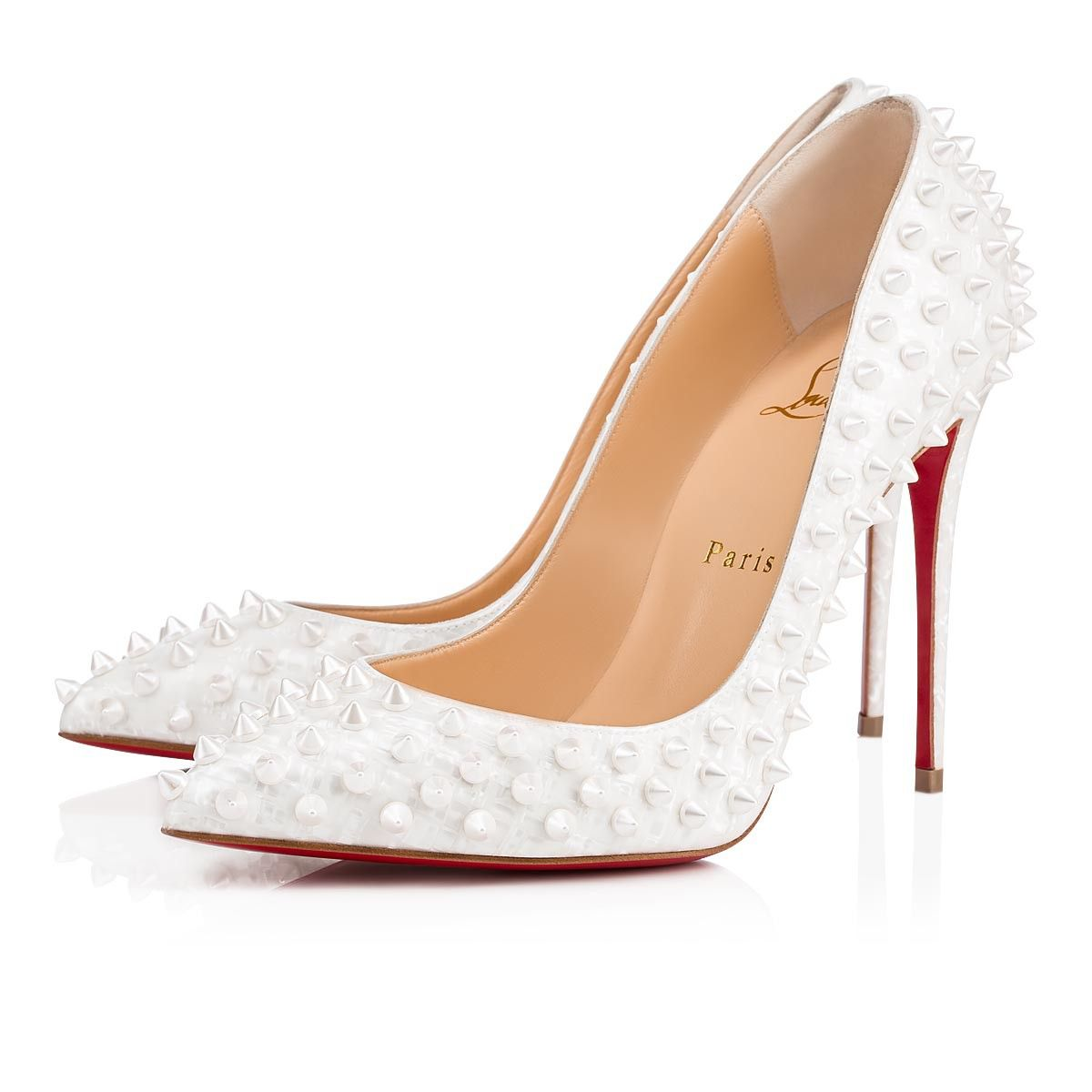 28f47b4c9903 Sport a uniquely Parisian look with the timeless elegance of Christian  Louboutin s Follies Spikes pumps. A mother of pearl motif printed on foil  then ...