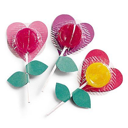 Lollipop Flowers Valentines Materials: Red and green construction paper or card stock Scissors Lollipop Glue stick Instructions: From red construction paper, cut out a heart that's just larger than the lollipop candy & glue it to the wrapper. For the leaves, fold the green paper in half & cut out a leaf shape, leaving the two sides attached at the seam. Unfold the double leaf shape, coat the entire inside surface with glue, & fold it back over the lollipop stem, pressing to secure.