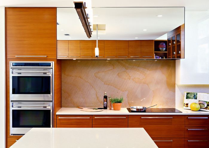We can't make up our minds. Does this backsplash look more like marble or wood? Photo by Chancey Design.
