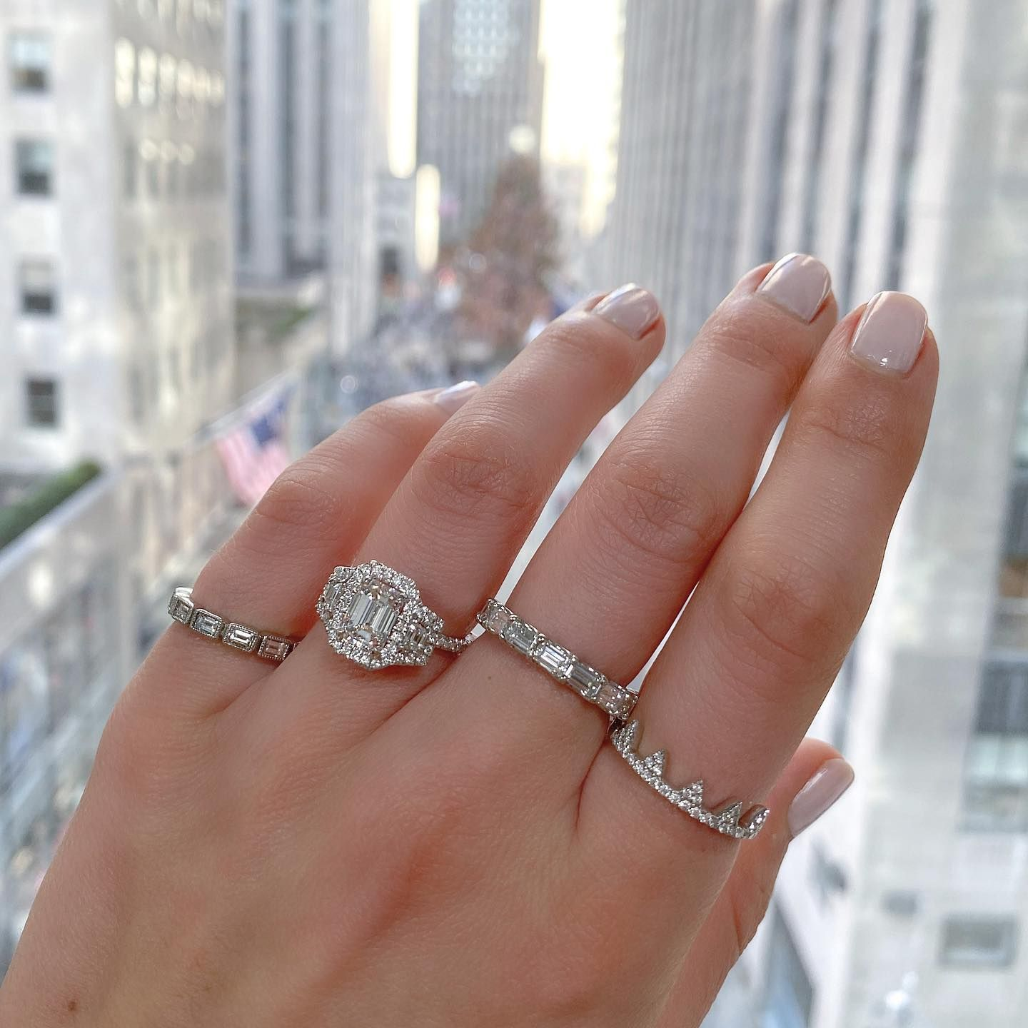 We spy.....🎄! Views from our office at Roc Center 😍 Only one more sleep till Santa 🎅🏻💍❤️ - Emerald cut three stone ring style # SOR-17882 - #laurenbjewelry #emeraldcut #diamondengagementring #threestonering #rockefellerchristmastree