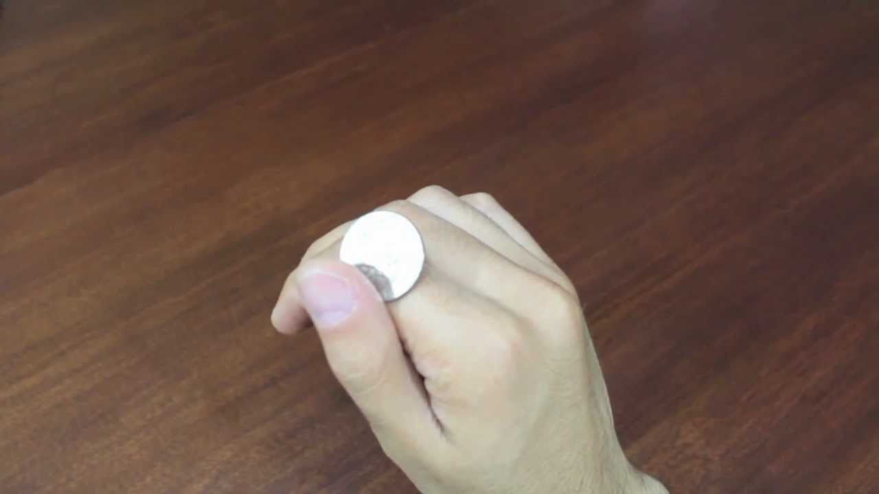 picture How to Roll a Coin on Your Knuckles