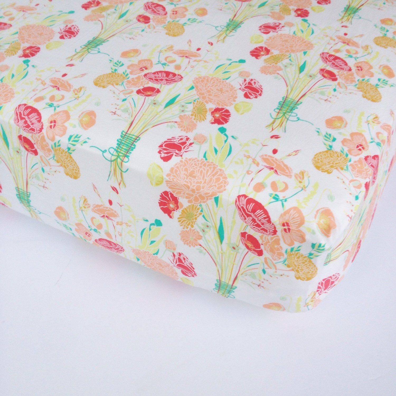 A personal favorite from my Etsy shop https://www.etsy.com/listing/106502439/girls-baby-bedding-floral-crib-sheet