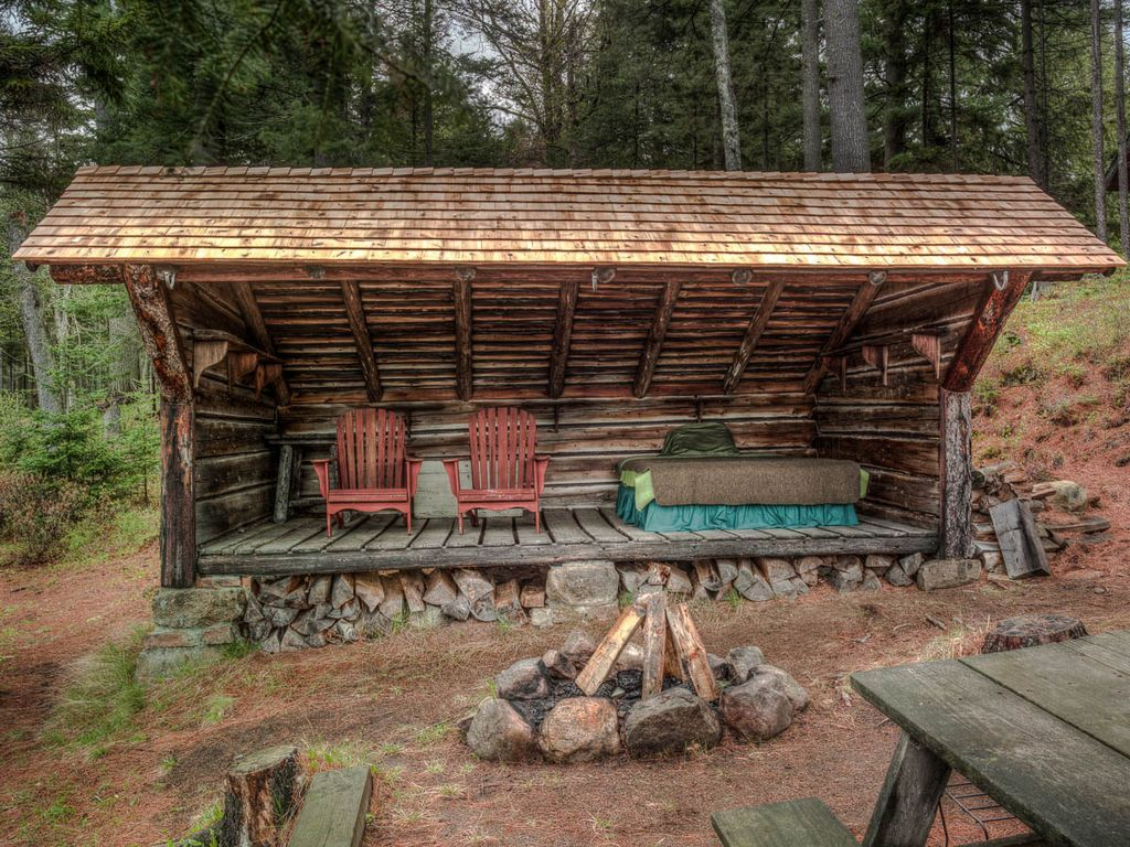 rustic landscape yard with fire pit deluxe adirondack chair