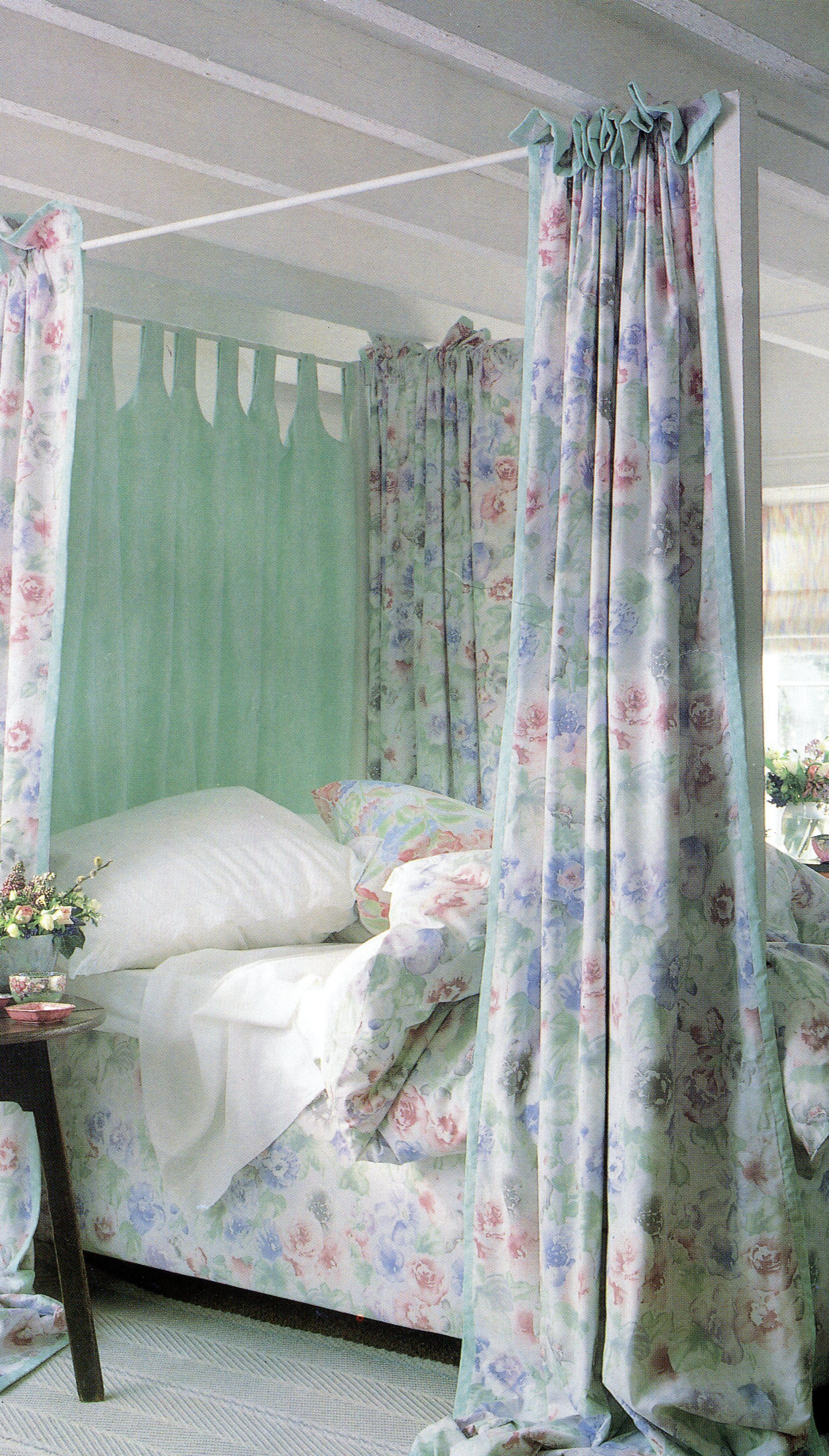 Creating a contemporary fourposter bed with ruched curtains and