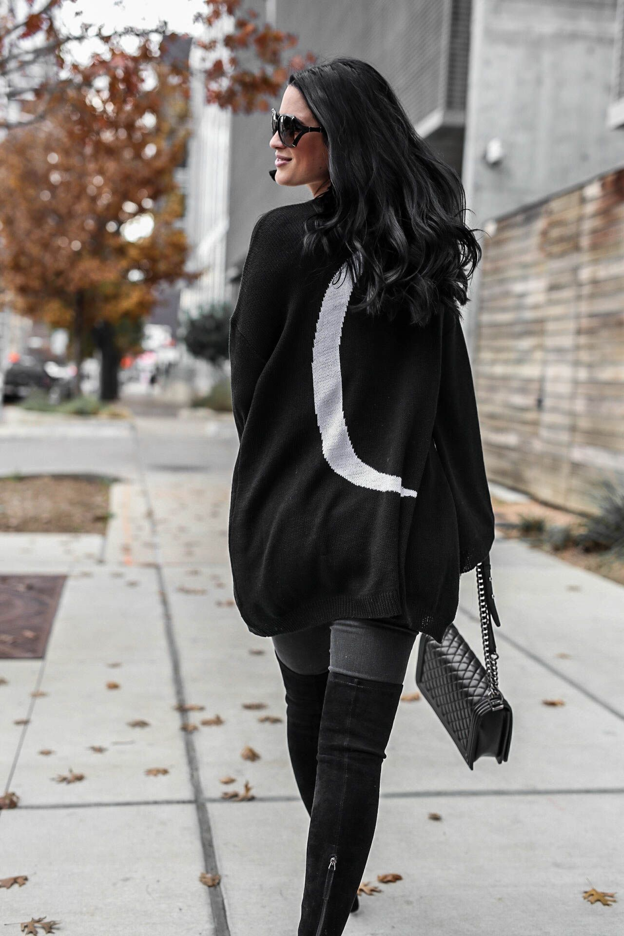 e8d6c9eebc40 ... off an all black look as well as why she has an affinity for stars and  moons. Cardigan from Show me Your Mumu.